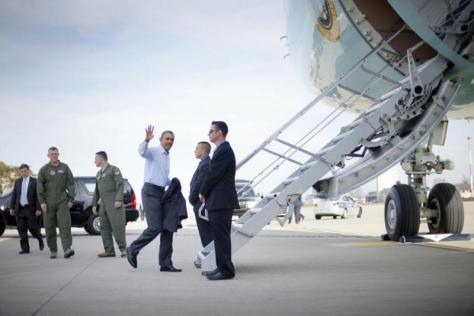 President Obama boards Air Force One at Ramstein Air Base, Saturday, March 29, in Germany. Air Force One was making a scheduled refueling stop in Germany and he was using the opportunity to meet with US members of the military.