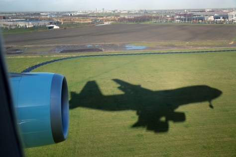 The shadow of Air Force One moves along the ground during landing at Schiphol International Airport in Amsterdam, the Netherlands, March 24, 2014. (Official White House Photo by Pete Souza)