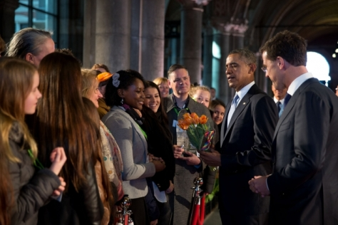President Barack Obama, with Prime Minister Mark Rutte, is presented with a bouquet of tulips after arriving at the Rijksmuseum in Amsterdam, the Netherlands, March 24, 2014. (Official White House Photo by Pete Souza)
