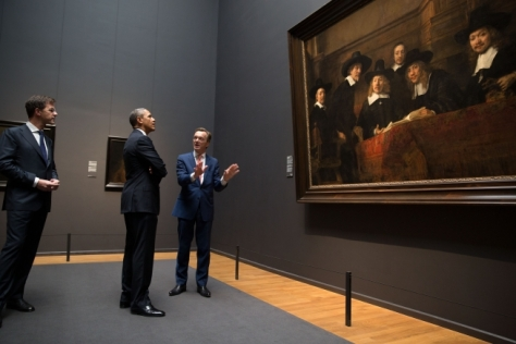 "President Barack Obama looks at Rembrandt's ""The Syndics"" with Prime Minister Mark Rutte, left, and Museum Director Wim Pijbes during a tour of the Gallery of Honor at the Rijksmuseum in Amsterdam, the Netherlands, March 24, 2014. (Official White House Photo by Pete Souza)"